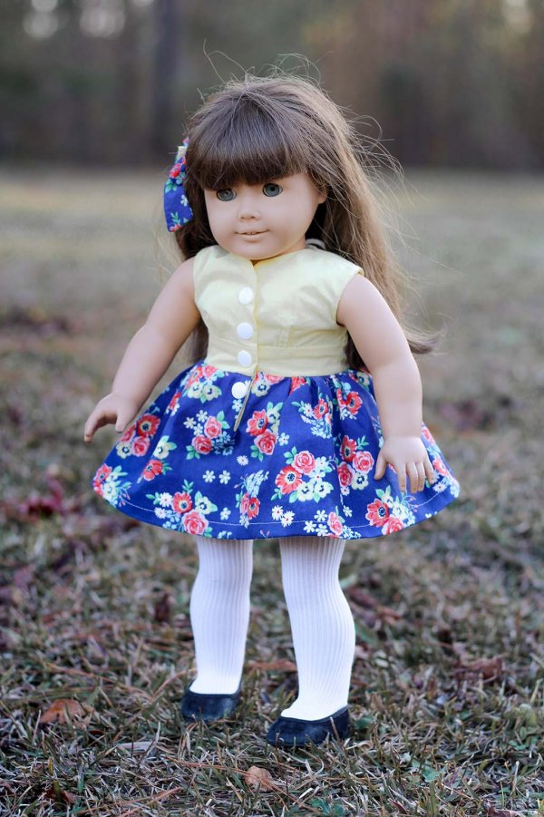 Opal doll dress, yellow top with flowered blue skirt