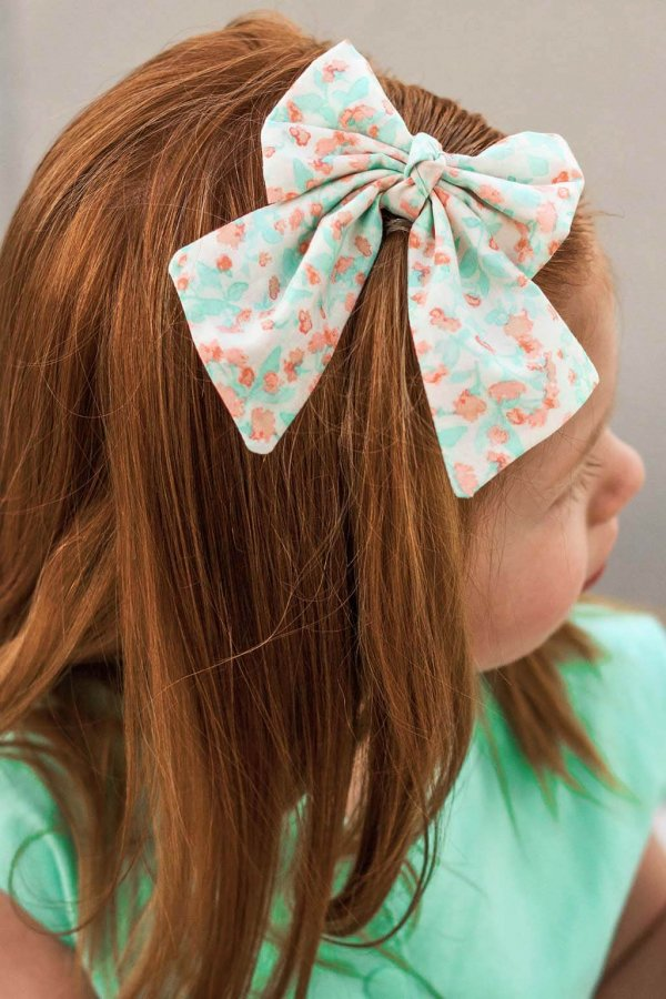 Opal girls hair bow, mint green & coral, twisted center