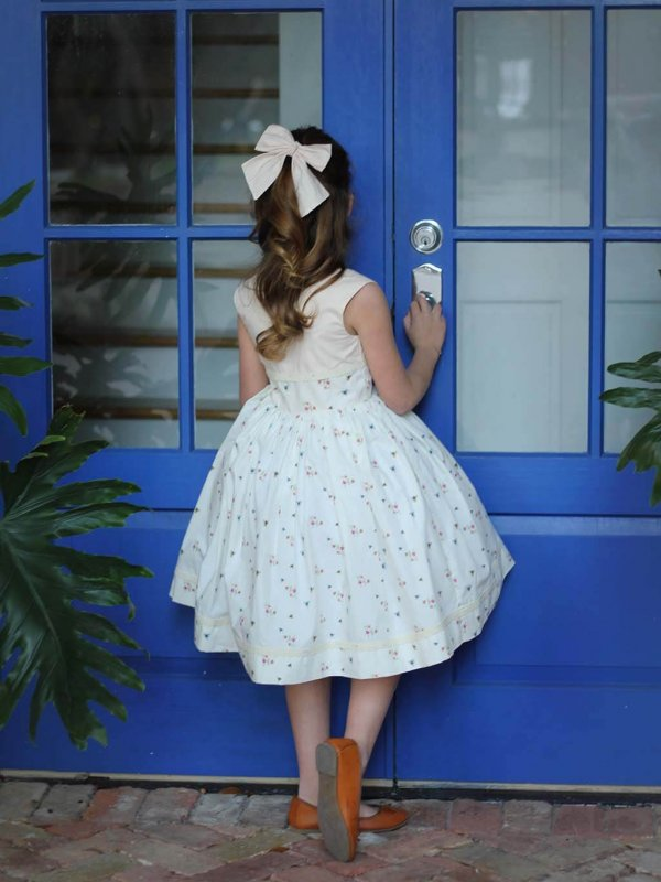 Opal vintage dress and bow, blue door back view