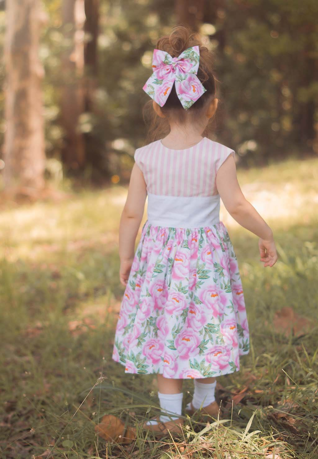 Opal little girls dress with striped top and flowered skirt, matching hair bow