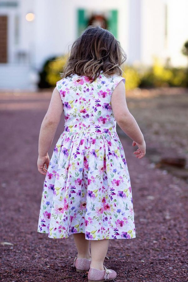Opal little girls dress back view with pink & purple flowers