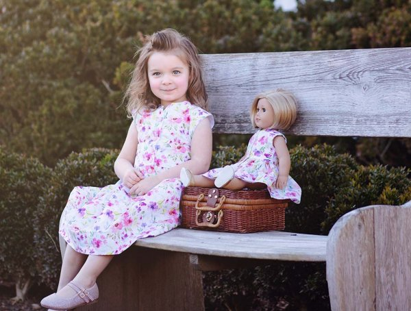 flowered doll dress matches little girl's dress