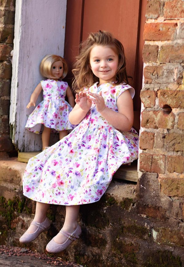 little girl and doll in matching pink & purple flowered Opal dresses