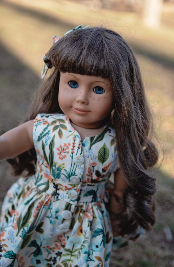 doll close up in Opal vintage flowered calico dress