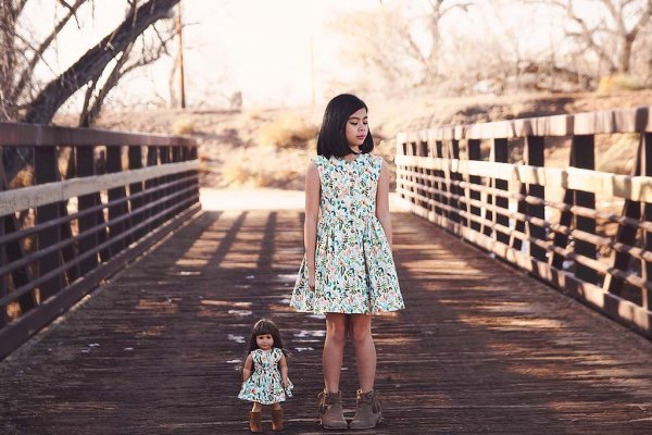 girl and doll taking a walk in matching Opal vintage flowered dresses
