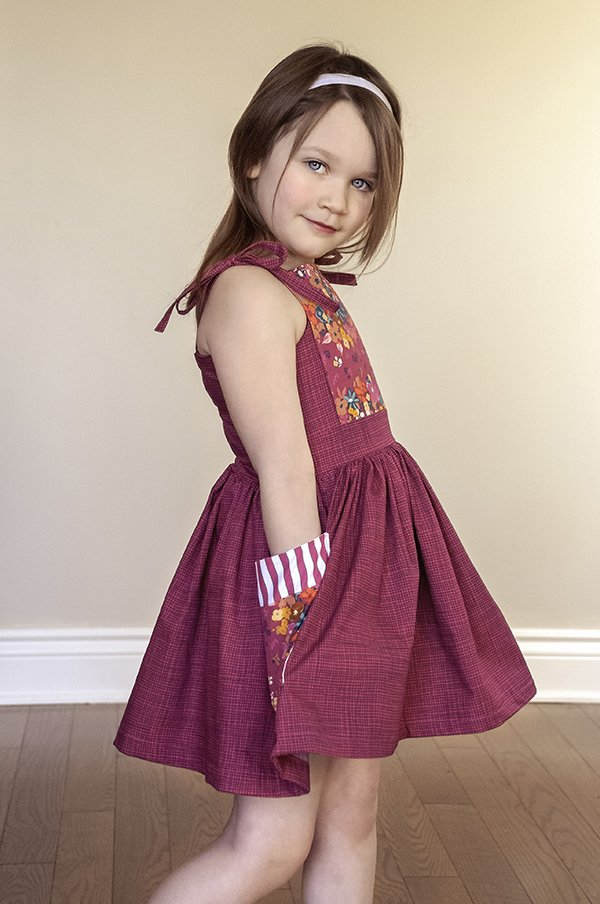 girls burgundy dress with matching bib and pockets