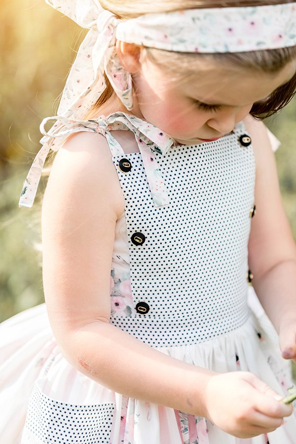 Bristol little girls dress bib with buttons