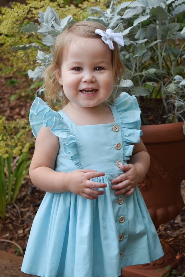 ruffled light blue baby Baker dress