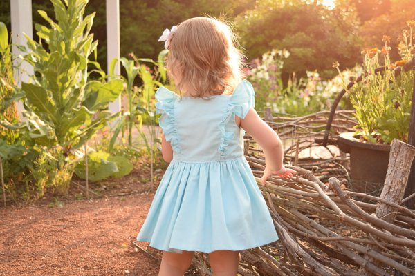 baby Baker dress light blue with ruffles