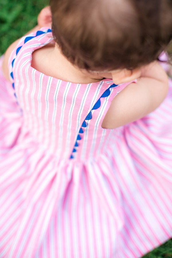 pink & white striped baby Baker