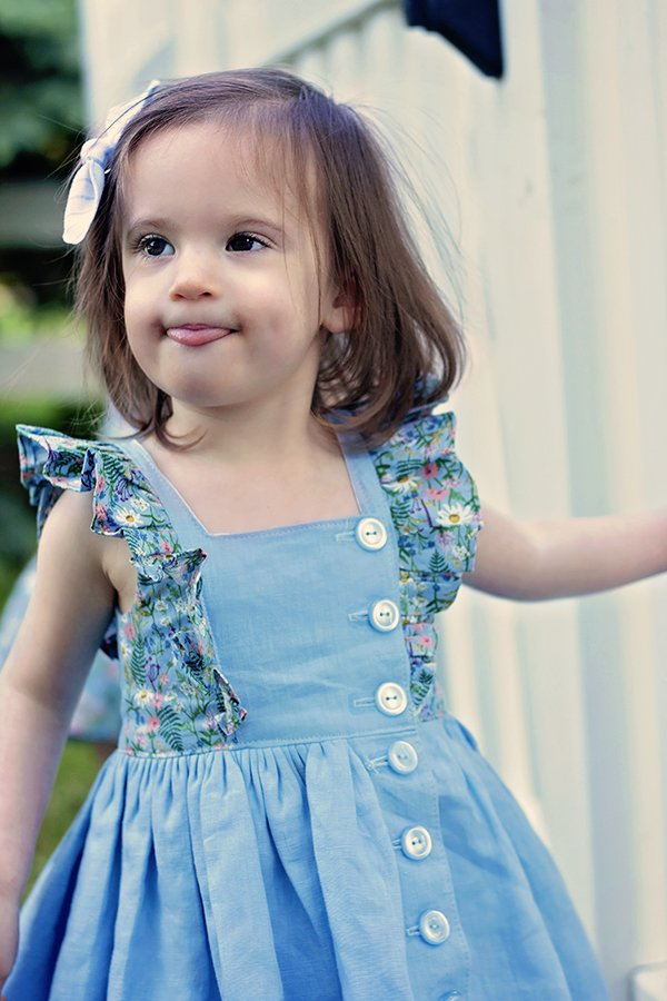 pale blue Baker baby dress with flowered trim