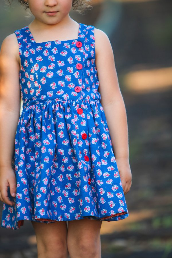 Baker girls dress with red buttons