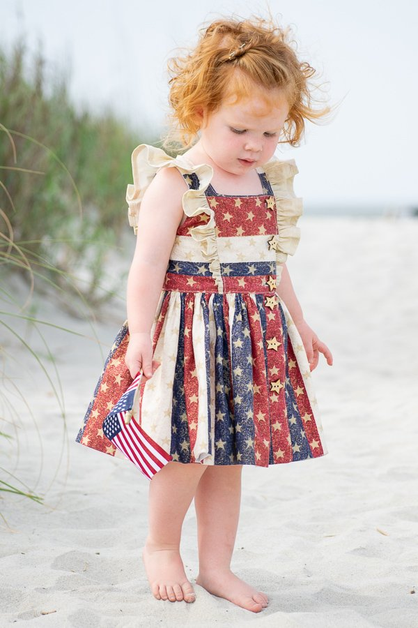 Baker girls dress with stars and ruffles