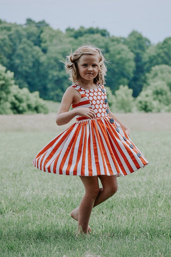 Baker girls dress orange stripes